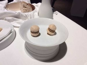 Photograph of two rabbit macaroons on a warmed white platter.